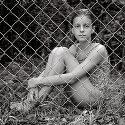 Marie Behind Fence