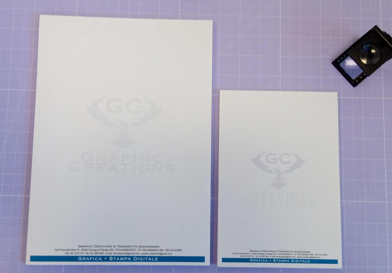 Grafica stampa realizzazione blocchi appunti Graphic Creations in formato A4 e A5 stampati a colori su carta usomano e rilegati a colla sul lato superiore con sottoblocco in cartoncino