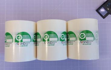 Grafica e realizzazione etichette  SND Industriale Civile stampate a colori su polipropilene in bobina e fustellate