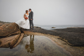 Bride and groom on the rocks