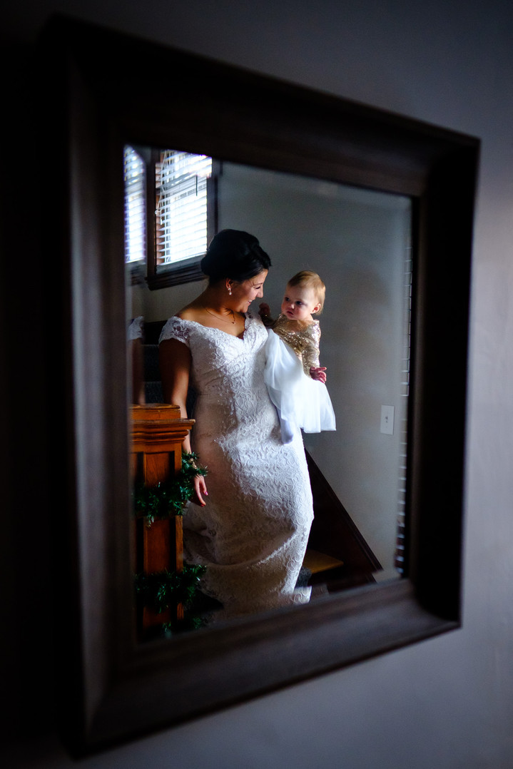 Bride and her daughter on stairs