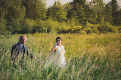 Bride and Groom in the Tall Grass