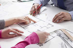 Hand pointing architectural blueprint. o