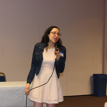 Samantha speaking at a conference.