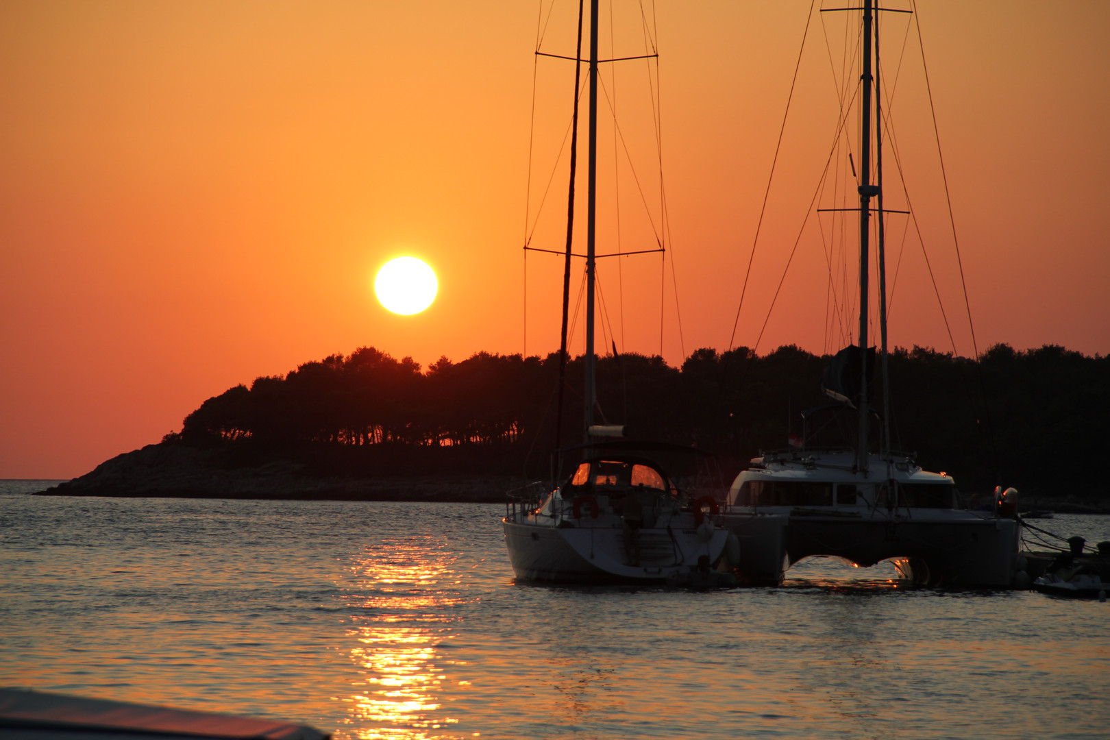 Sunset with sailboats | Maslinica