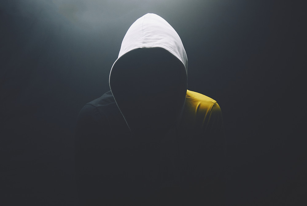 black background and white light portrait hoodie anonymous