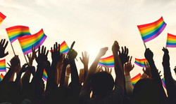 pride-flags-hands-featured