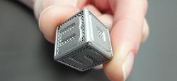 3D-Systems_DMP_Cufflink_in_Fingers-760w-web_0_0