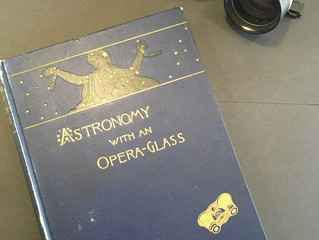 Astronomy, perspective, opera glasses and a small dog.