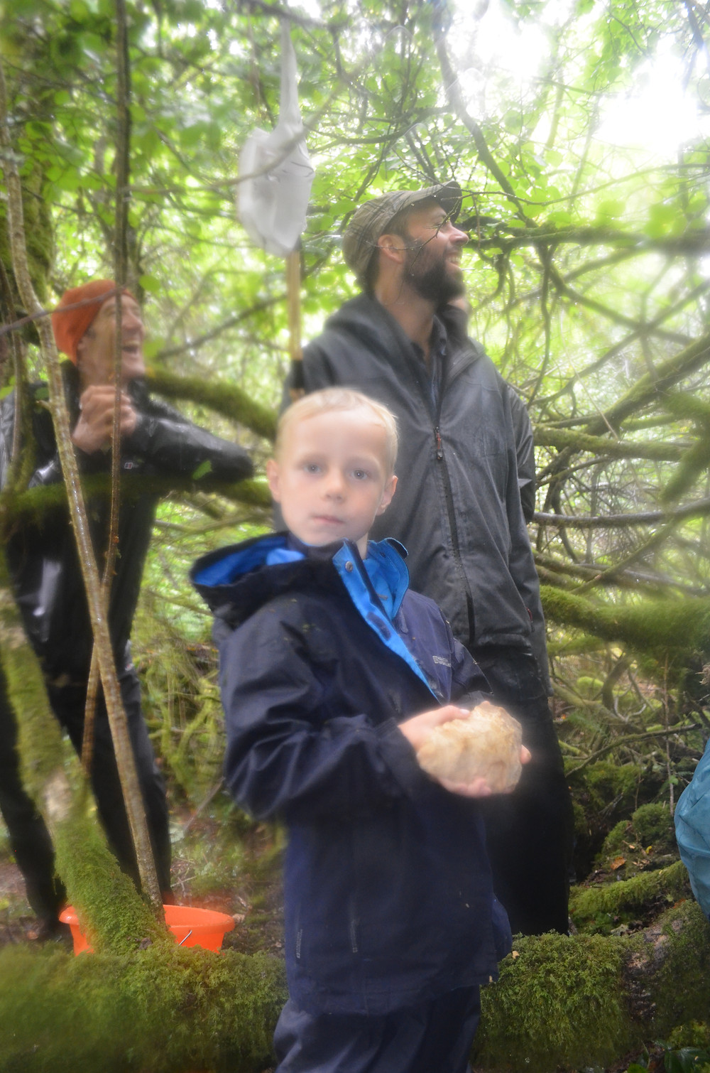 A young archaeologists with a Palaeolithic hand axe.