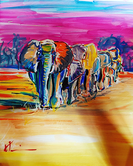 Elephants at sunset in a line
