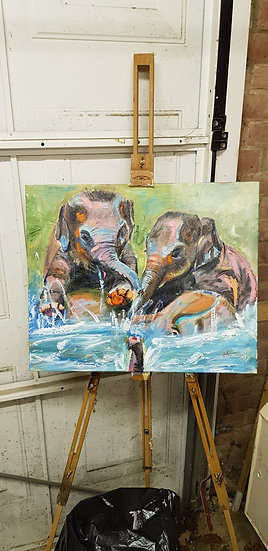 Two baby elephants playing in the water with mum.  #SOLD
