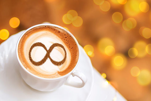 a cup of cappuccino coffee with a symbol