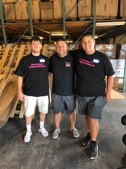 Thomas, Jerry, and Michael in the warehouse at the United Breast Cancer Foundation Mattress Give Away Event