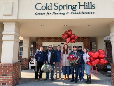 The Cupid Crew a.k.a. the Gold Coast Team at Cold Spring Hills Rehabilitation Center visiting residents on Valentine's Day.