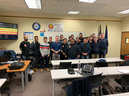 Tom Stackpole with students at the Electrical Training Center.