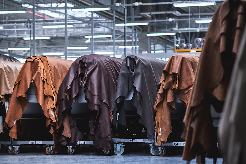 Genuine leather being finished at a tannery