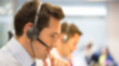 Call-center-team-at-office-on-the-phone-with-headset-466197661_1255x837.jpeg