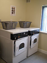 Two tumble driers located in the marina's laundry room.