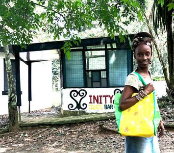 Sister Imara Solwazi in front of Inity Juice Bar, Cafe & Giftshop