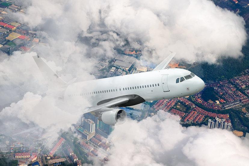 airplane-above-the-city-WMZ6EXP.jpg