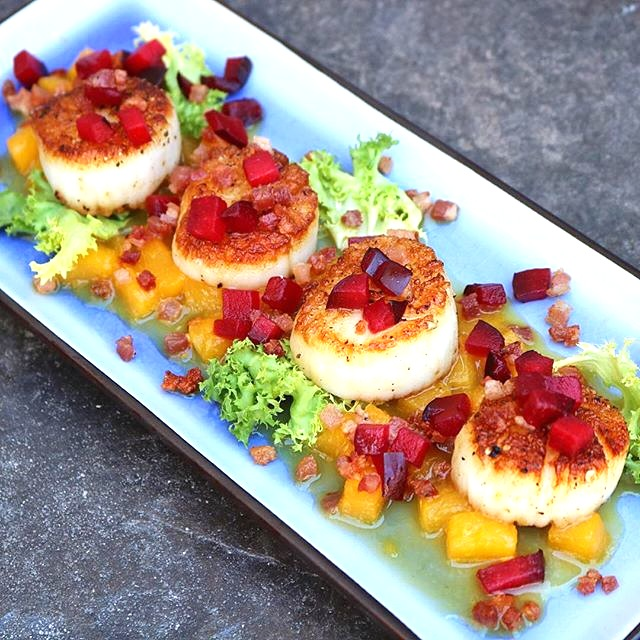 Pan seared sea scallops with peach sauce topped with crispy pancetta and diced plum_edited