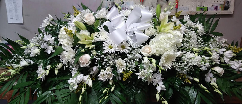 WHITE FULL CASKET WITH ORCHIDS