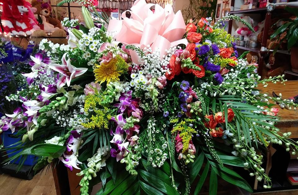 MIXED HALF CASKET SPRAY WITH ORCHIDS