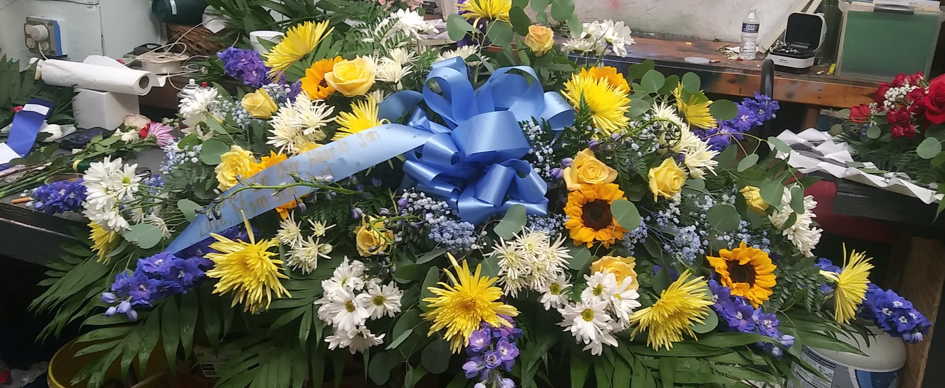 .FULL CASKET SPRAY WITH SUNFLOWERS