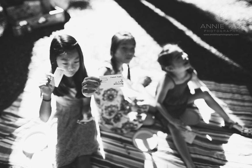 East-Bay-styled-children-photography-children-holding-up-game-cards-BxW