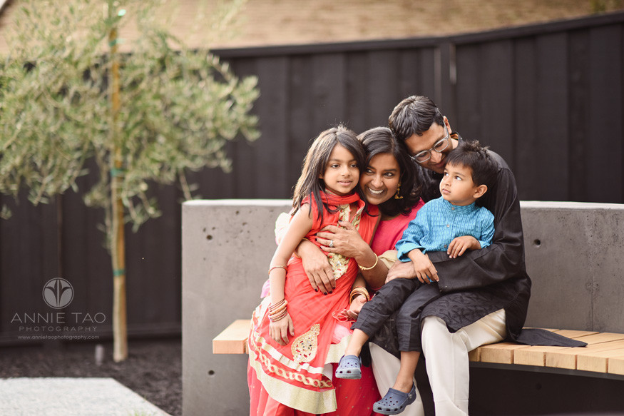 East-Bay-family-photography-dressed-up-for-diwali-and-hugging-on-circular-bench