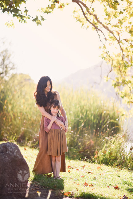 Bay-Area-lifestyle-family-photography-woman-hugging-and-gazing-at-her-daughter-by-lake