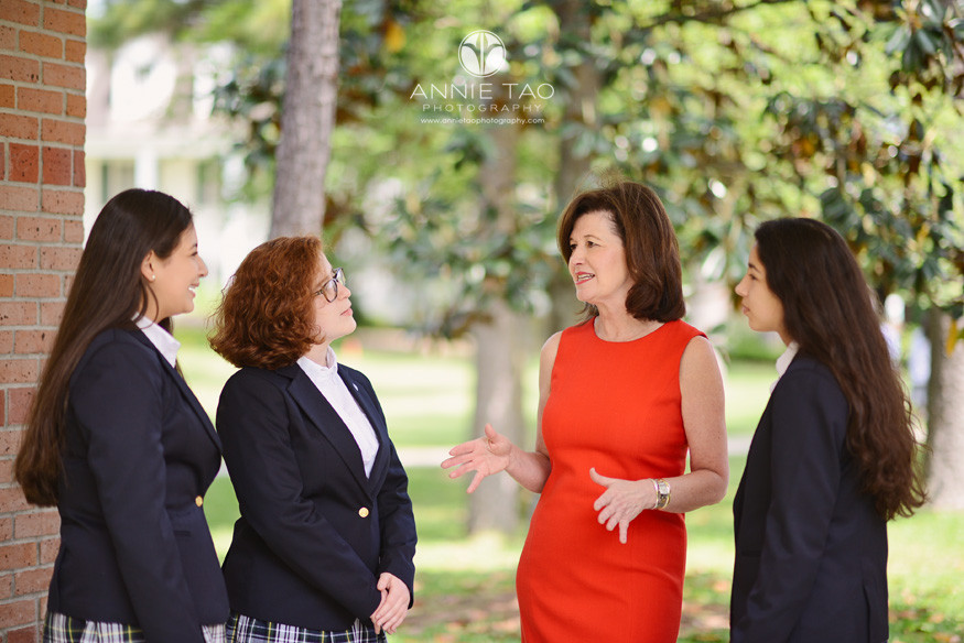 Commercial-education-photography-Head-of-School-talking-with-students-wearing-blue-blazers
