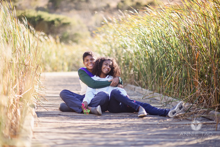 South-Bay-lifestyle-children-photography-siblings-hugging-on-marsh-walkway