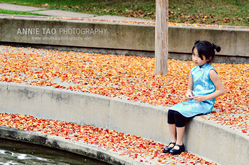 San-Francisco-Bay-Area-child-model-photography-Asian-doll-sitting-among-leaves-far