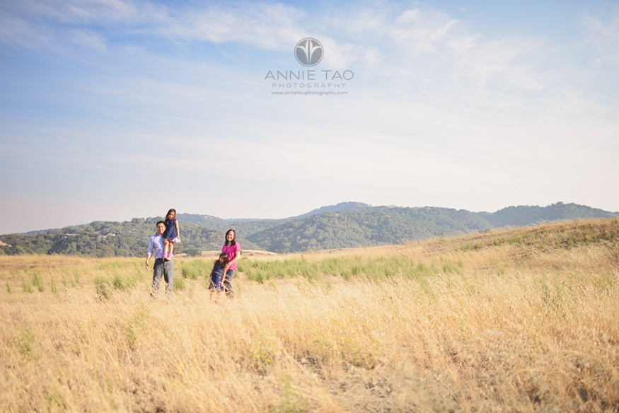East-Bay-children-lifestyle-photography-family-standing-in-field-overlooking-hills