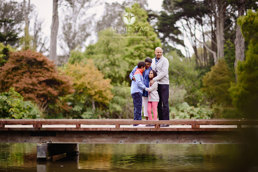 San-Francisco-lifestyle-family-photography-man-hugging-his-family-tightly-on-bridge