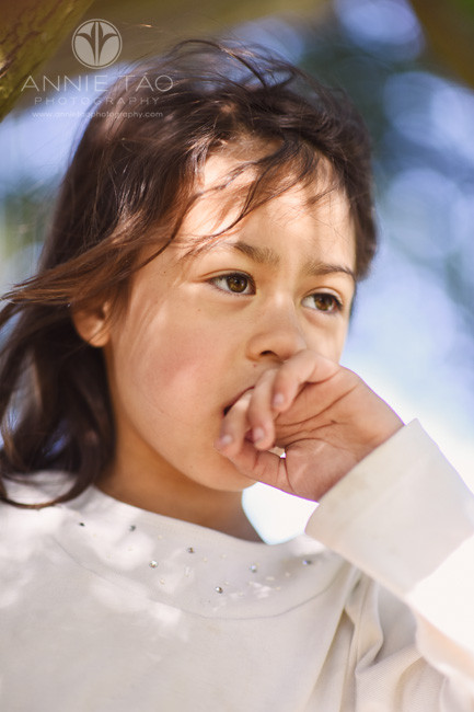 East-Bay-lifestyle-children-photography-young-girl-with-her-hand-to-her-mouth-closeup