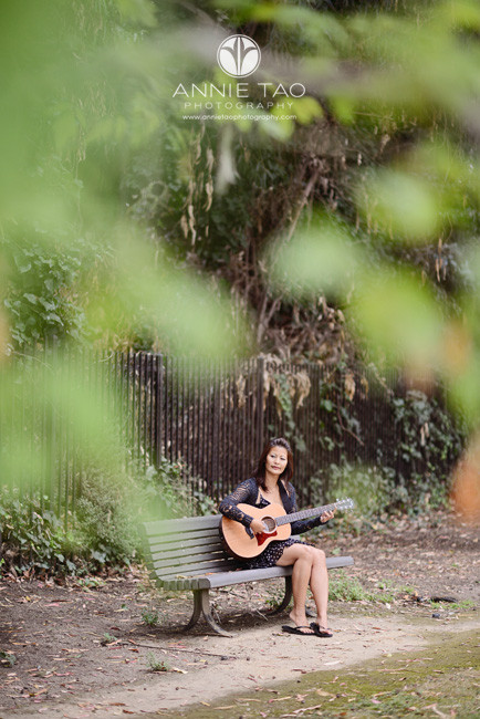 East-Bay-styled-photography-woman-playing-guitar-on-bench