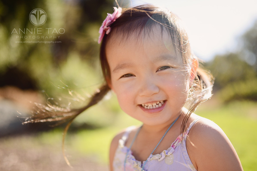 East-Bay-lifestyle-children-photography-young-girl-with-pigtails-standing-in-the-sunlight