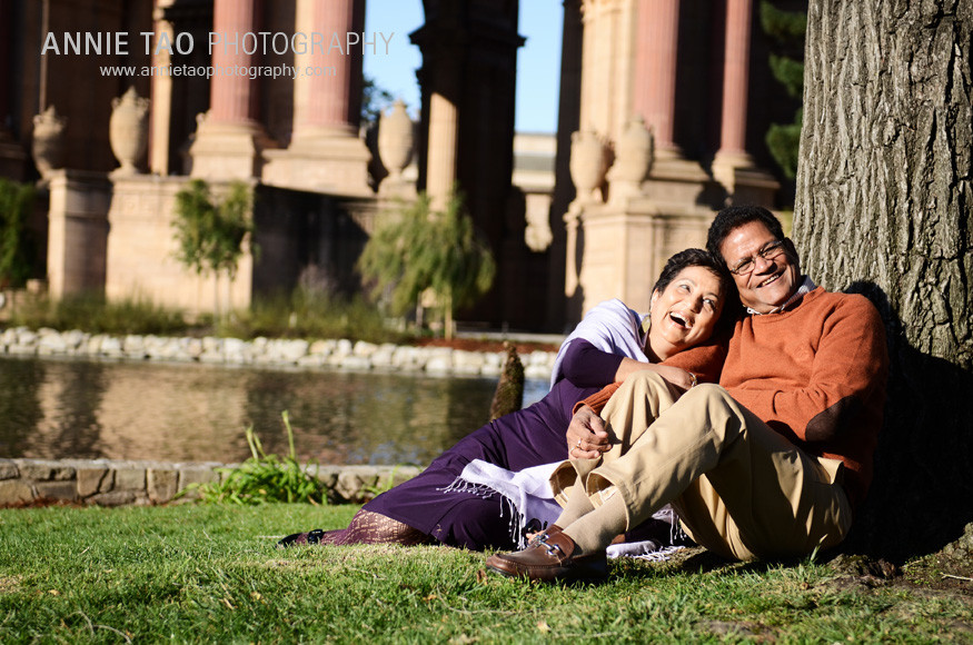 San-Francisco-Bay-Area-family-photography-grandparents-sitting-by-tree-at-Palace-of-Fine-Arts
