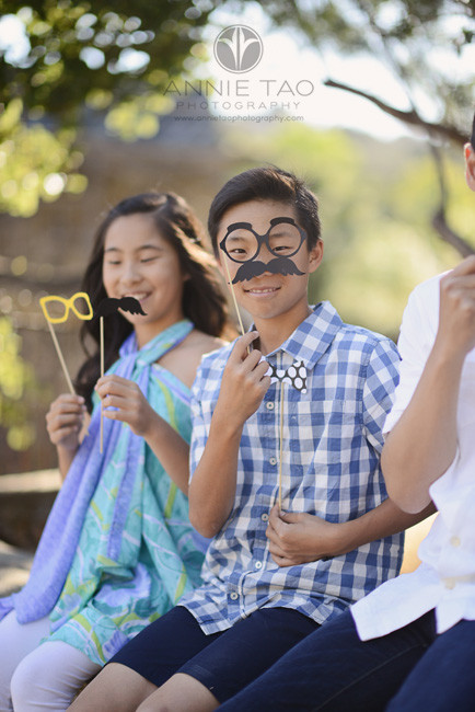 Bay-Area-lifestyle-children-photography-preteen-boy-holding-silly-face-props
