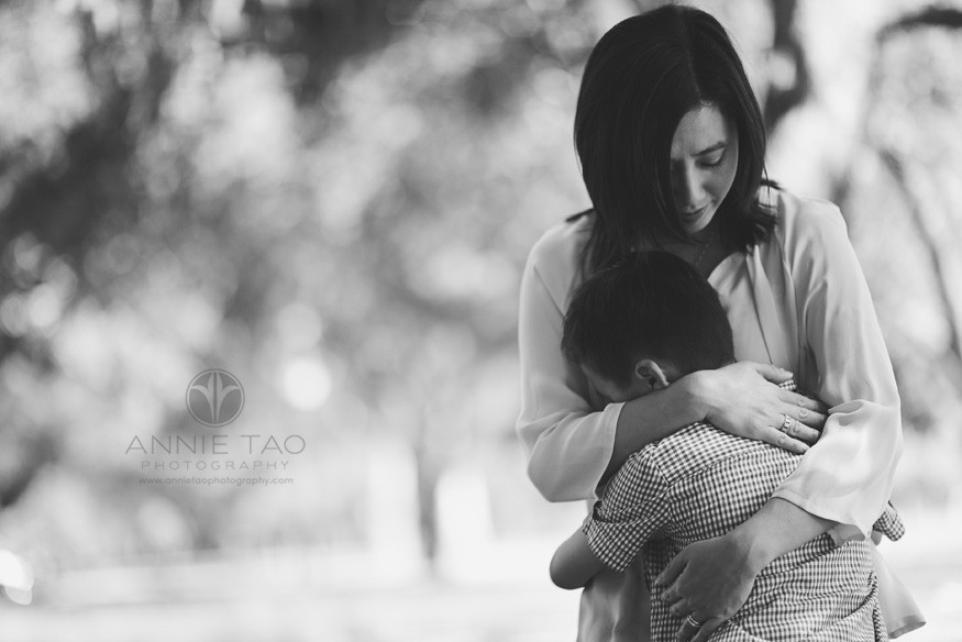 Bay-Area-lifestyle-children-photography-young-boy-hugging-mom-for-comfort-after-a-fall-BxW