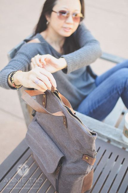 east-bay-lifestyle-product-photography-annie-tao-unzipping-top-of-camera-bag