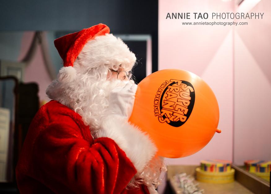 AnnieTao_SuperFranks_Santa-blowing-up-a-SuperFranks-balloon