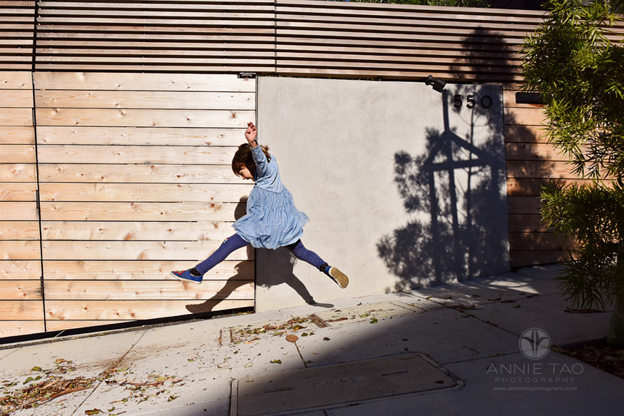 San-Francisco-lifestyle-children-photography-young-girl-leaping-on-sidewalk-with-shadows