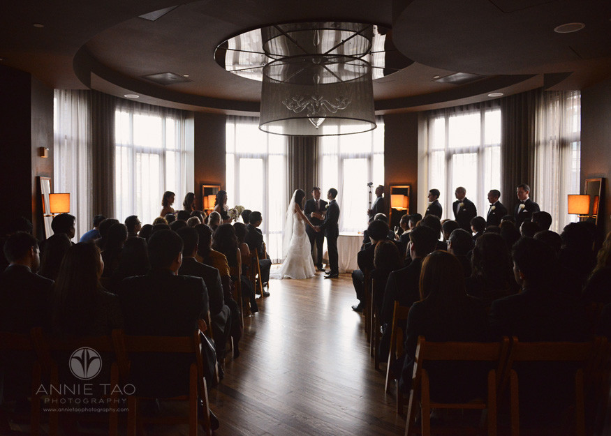 San-Francisco-wedding-photography-hotel-vitale-bride-and-groom-holding-hands-at-the-alter-during-ceremony
