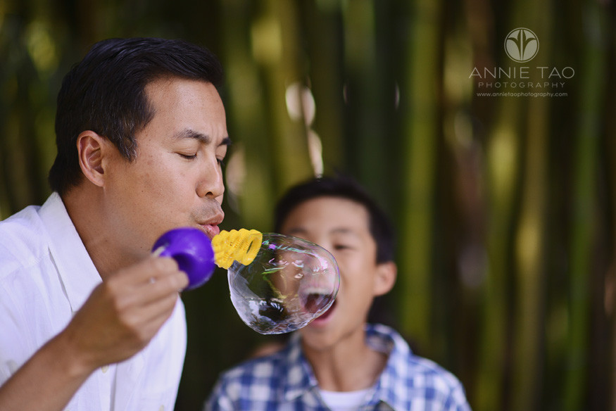 Bay-Area-lifestyle-family-photography-son-pretending-to-eat-bubble-blown-by-dad