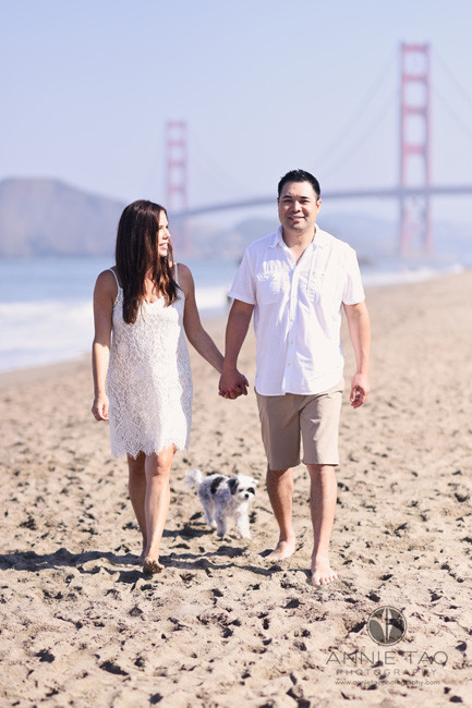 San-Francisco-lifestyle-photography-couple-walking-together-at-beach-with-their-dog