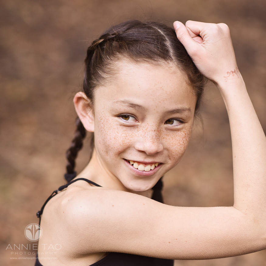 east-bay-styled-children-photography-girl-with-freckles-smiling-with-arm-up